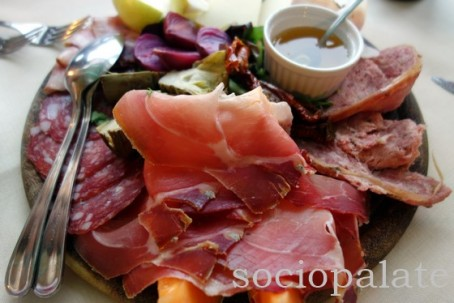 tuscan antipasto platter with cured meats and cheeses