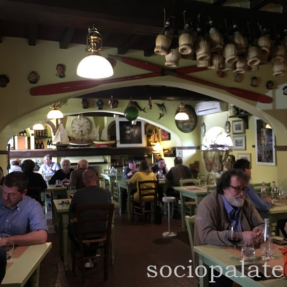 Trattoria i Nanni cozy dining room filled with locals at lunch